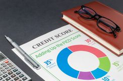 Credit score on a desk and calculator. Credit rating on the gray table, pen, glasses and calculator stock photo