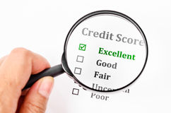 Credit score form with magnifier glass. Credit score form with hand holding magnifier glass Stock Photo