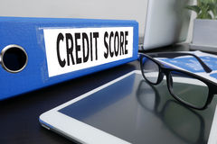 CREDIT SCORE. Office folder on Desktop on table with Office Supplies. ipad stock photos