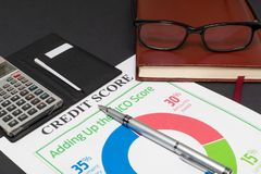 Credit score report with calculator. Credit score report with keyboard and notepad stock photos