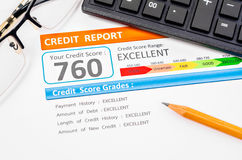 Credit score report. Credit score report with calculator, glasses and pencil on table stock photography