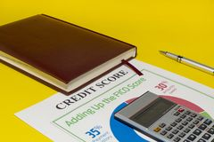 Credit score report with calculator. Credit rating report with keyboard, pen and notepad stock images