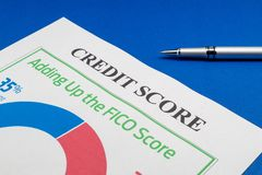 Credit score report and pen on the blue table. Credit score report with pen on the blue table for a site about a business stock images