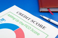 Credit score report with pen and notepad. On a blue table royalty free stock images