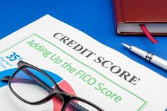 Credit score report with pen and notepad. On a blue table royalty free stock photos