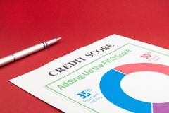 Credit score report and pen on the red table. This is a credit score report with pen on the red table royalty free stock photo