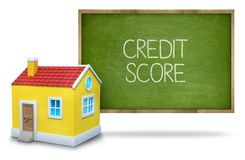 Credit score text on blackboard with 3d house Stock Photo