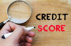 Credit score text concept. Human hand over wooden background and credit score text concept Royalty Free Stock Image