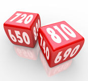 Credit Scores on Red Dice. Two red dice with credit scores on their faces Royalty Free Stock Photo
