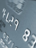 Credit spin. Closeup of credit card with spin effect on the number nine stock photo