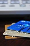 Creditcard drie en telefoon Royalty-vrije Stock Foto's