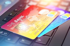 Creditcards op laptop toetsenbord Royalty-vrije Illustratie