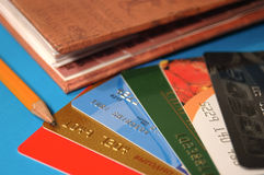 Credits. Credit cards and a notebook Stock Photography