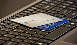 Credits cards on a computer keyboard. Laptop keyboard with credit cards, selective focus Stock Photography