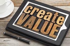 Cree el valor en la tableta digital imagen de archivo