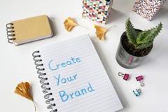 Cree su marca escrita en un cuaderno foto de archivo libre de regalías