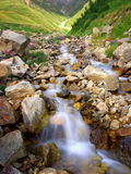 Creek. Amongst yellow stone in valley. Natural composition Royalty Free Stock Photo