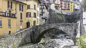 Creek in an ancient village. Old brige over a creek in a small village on Como Lake riverbanks stock photo