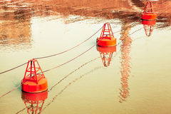 The creek in the buoy. Red buoy, a warning role in water Stock Photo