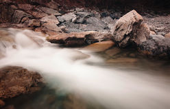 Creek flowing over the rocks Royalty Free Stock Photos
