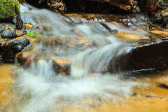 Creek flowing over the rocks Stock Photos