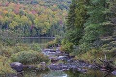 A creek flows into Lake Bouchard Stock Photo