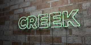 CREEK - Glowing Neon Sign on stonework wall - 3D rendered royalty free stock illustration. Can be used for online banner ads and direct mailers stock illustration