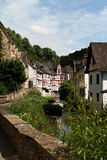 Creek lined with historic houses in the medieval village Monreal Royalty Free Stock Photo