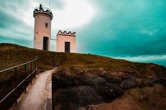 Creek Lovely Lighthouse Scotland United Kingdom. Lighthouse in Scotland,amazing sky in a wonderfull summer day Stock Photos