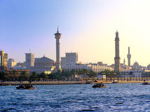 Creek and Minarets. View of the Dubai creek, dhows and minarets Royalty Free Stock Image