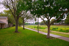 Creek park with track and green lawn grass Stock Image