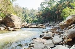 Creek and river in Thailand. Creek and river flowing through along rocks in summer season, Ob Luang National Park, Chiangmai, Thailand stock images