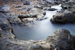 Creek. With rock from lava Stock Images