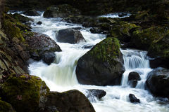 Creek with running water and stones (rocks) Stock Photo