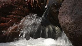 Creek spilling and swirling over rocks stock video