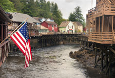 Creek Street and the USA flag in a rainy day, Ketchikan. stock photography