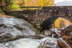 Creek Underneath Stone Bridge in Fall Royalty Free Stock Photo