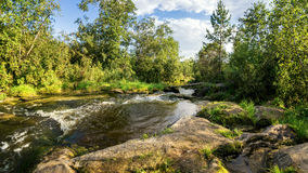 Creek, waterfall, water, river, rocks, cliff, nature, landscape, summer, autumn, day, Bush, forest, grass, reeds, moss, leaves, pu Stock Photography