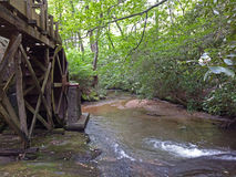 Creekside Mill. An old gristmill next to a small stream royalty free stock image