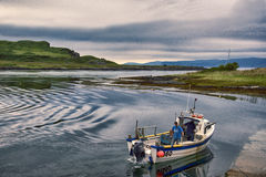 Creel Boat. Coming into the Isle of Seil, across form the Isle of Luing, Scotland Stock Images