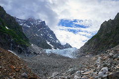 Creeping glacier high in the mountains Stock Image