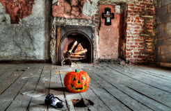 Creepy attic. With halloween pumpkin and skull lantern Stock Image