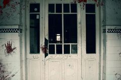 Free Creepy Bloody Door Of The Haunted Asylum. Abandoned And Decayed Building Of Psychiatric Hospital Royalty Free Stock Image - 146801586