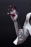 Creepy bloody zombie hand. Body-art, studio shot Royalty Free Stock Photo