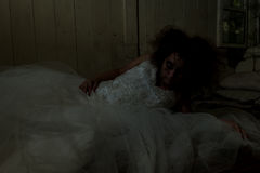 Creepy bride in bed Stock Photos