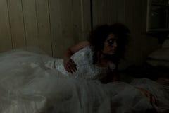 Creepy bride. In creepy devastated room royalty free stock photo