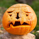 Creepy carved pumpkin face Stock Photo