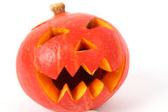 Creepy carved pumpkin face with white background Royalty Free Stock Images