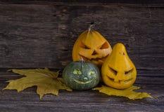 Creepy carved pumpkin faces Royalty Free Stock Photos