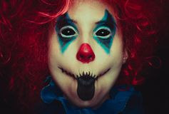 Creepy clown close up halloween portrait on black background. Creepy clown close up spooky halloween portrait on black background royalty free stock photography